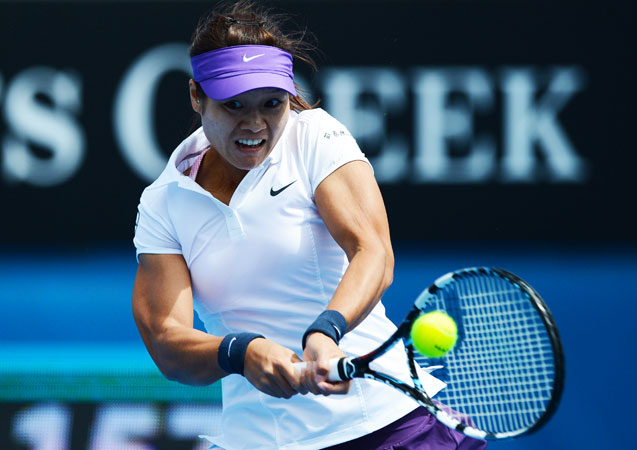 China's Li Na hits a return against Kazakhstan's Sesil Karatantcheva during their women's singles first round match.