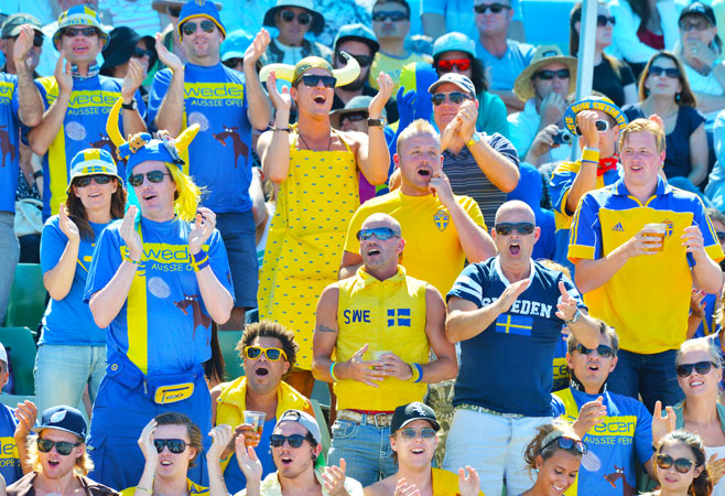 Fans of Sweden's Johanna Larsson cheer during her women's singles first round match against Serbia's Jelena Jankovic.