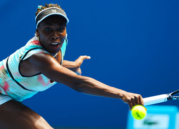 Venus Williams of the US hits a return against Kazakhstan's Galina Voskoboeva during their women's singles first round match.