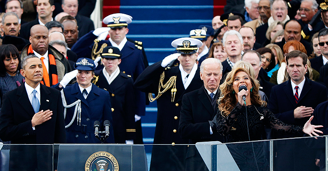 Beyonce (R) sings the national anthem as U.S. President Barack Obama (L) and Vice President Joe Biden (2nd R) look on during the swearing-in ceremonies on the West Front of the U.S. Capitol in Washington, January 21, 2013. REUTERS/Jason Reed (UNITED STATES  - Tags: POLITICS)