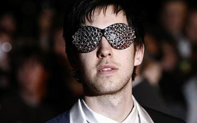 DJ Calvin Harris poses for photographers as he arrives for the Brit Awards at Earls Court in London, February 18, 2009.