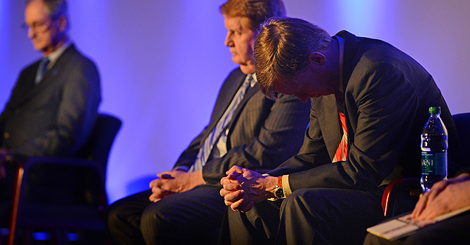 Colorado Gov. John Hickenlooper bows his head during a prayer at the reopening and remembrance ceremony at the Century Aurora cinema, formerly the Century 16, Thursday, Jan. 17, 2013 in Aurora, Colo. The cinema is where 12 people were killed and dozens injured in a shooting rampage last July. (AP Photo/The Denver Post, RJ Sangosti, Pool)