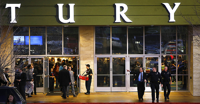 AURORA, CO - JANUARY 17: Invited guests make their way into a reopening ceremony and evening of remembrance at the Cinemark Century 16 Theaters as security patrols on January 17, 2013 in Aurora, Colorado. The theater was the site of a mass shooting on July 20, 2012 that killed 12 people and wounded dozens of others.   Marc Piscotty/Getty Images/AFP== FOR NEWSPAPERS, INTERNET, TELCOS & TELEVISION USE ONLY ==