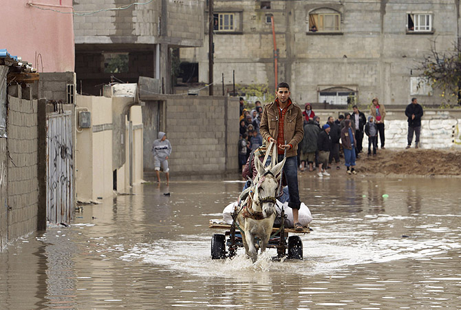 A Palestinian rides a donkey cart through a flooded street caused by heavy rain in Rafah in the southern Gaza Strip.?Photo by Reuters