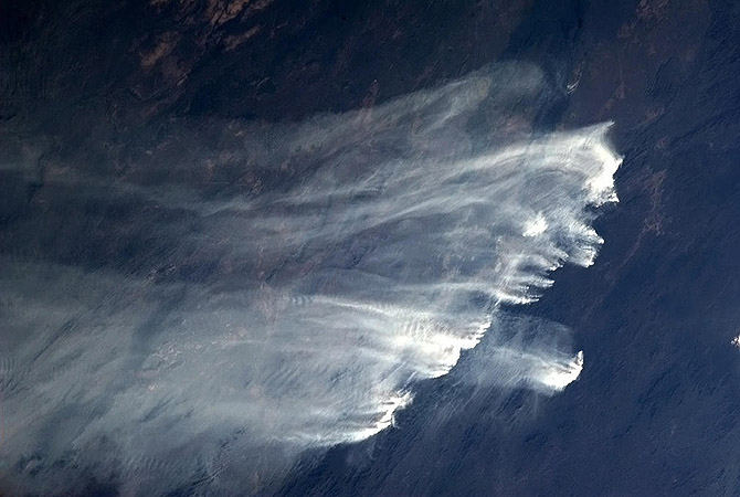 Bushfires in Australia are pictured in this January 2, 2013 handout photo taken by Canadian astronaut Chris Hadfield aboard the International Space Station.?Photo by Reuters