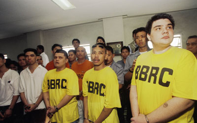 This photo from the film 'Give Up Tomorrow' shows Francisco Juan Larranaga (R, in handcuffs) and his co-accused, listening to a reading of their verdict at a court in Cebu, central Philippines. —Photo by AFP