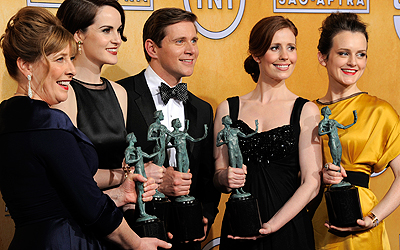 "Actors, from left, Phyllis Logan, Michelle Dockery, Allen Leech, Amy Nuttall and Sophie McShera pose backstage with the award for best ensemble in a drama series for ""Downton Abbey"". — AP Photo"