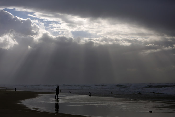 A person stands on the shores of the Mediterranean Sea on a stormy day at Nitzanim beach, near the southern city of Ashkelon.—Photo by Reuters