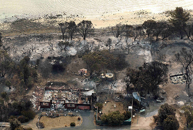 Houses destroyed by a bushfire are seen in ruins in Dunalley, about 40 kilometres (25 miles) east of Hobart. Over 100 homes have been destroyed in Australia's island state of Tasmania, with police saying that thousands of residents have been displaced by dozens of bush fires, driven by record high temperatures last week across the country. —Photo by Reuters