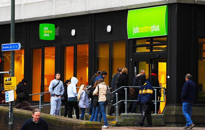 A file photo taken on January 20, 2010, shows people entering a job centre in Bromley, Kent, in south-east England. -Photo by AFP