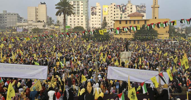Palestinians hold yellow Fatah flags during celebrations marking the 48th anniversary of the Fatah movement in Gaza City, Friday, Jan. 4, 2013.  Leaders of the Palestinian Fatah party led tens of thousands of supporters Friday in a mass rally in the Gaza Strip, the first such gathering for the largely secular party in the territory since the rival Islamist Hamas seized power there in 2007. - AP Photo