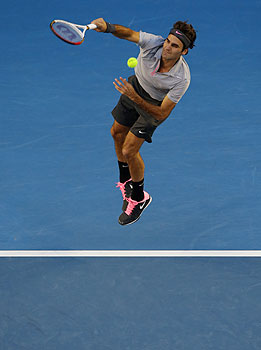 Federer serves to Australia's Bernard Tomic during their third round match. -Photo by AP