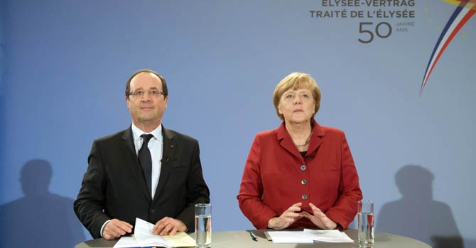French President Francois Hollande (L) and German Chancellor Angela Merkel address a press conference at the chancellery in Berlin on Jan 21, 2013, as part of the 50th anniversary of the Elysee Treaty. Hollande is in Berlin for sealing the countries' post-war reconciliation. The two-day festivities kick off with a debate with French and German youths.  - AFP Photo