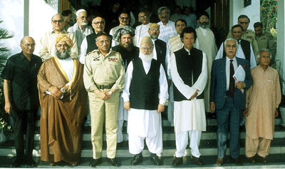 Qadri (third from right in the third row) was one of first civilian politicians to pledge his support to General Musharraf. Other leaders seen in the picture include, Maulana Fazalur Rehman, Imran Khan and Farooq Laghari.