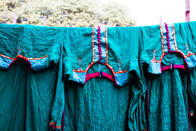 Kameez shirts laid out to dry after being dyed.