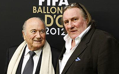 FIFA President Sepp Blatter is accompanied by French actor Gerard Depardieu (R) as he arrives before the FIFA Ballon d'Or 2012 Gala at the Kongresshaus in Zurich January 7, 2013. — Reuters Photo