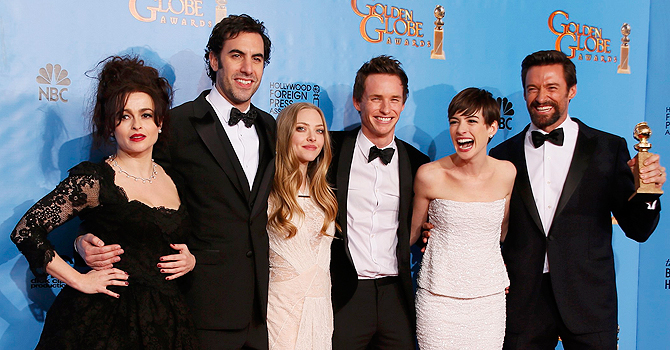 "The Cast of ""Les Miserables"" (From L:) Helena Bonham Carter, Sasha Baron Cohen, Amanda Seyfried, Eddie Redmayne, Anne Hathaway and Hugh Jackman celebrate their win for Best Motion Picture, Comedy or Musical backstage at the 70th annual Golden Globe Awards in Beverly Hills, California, January 13, 2013.  REUTERS/Lucy Nicholson (UNITED STATES  - Tags: ENTERTAINMENT) (GOLDENGLOBES-BACKSTAGE)"