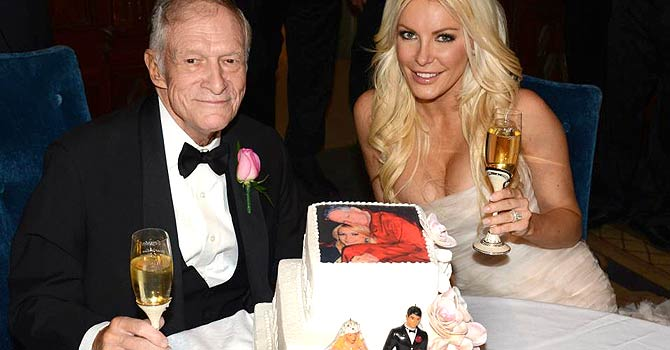"Octogenarian Playboy founder Hugh Hefner poses with his bride Crystal Harris at their New Year Eve wedding at the Playboy Mansion in Beverly Hills, California in this handout photo taken on December 31, 2012. Hefner briefly swapped his iconic silk pajamas for a tuxedo to marry Harris, the one-time ""runaway bride"" who followed through this time at the New Year's Eve wedding. The couple tied the knot more than a year after their planned 2011 wedding was scuttled when Harris got cold feet. REUTERS/Elayne Lodge/PEI/Handout (UNITED STATES - Tags: ENTERTAINMENT MEDIA) FOR EDITORIAL USE ONLY. NOT FOR SALE FOR MARKETING OR ADVERTISING CAMPAIGNS. THIS IMAGE HAS BEEN SUPPLIED BY A THIRD PARTY. IT IS DISTRIBUTED, EXACTLY AS RECEIVED BY REUTERS, AS A SERVICE TO CLIENTS. NO ARCHIVES. NO SALES"