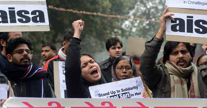 Indian protestors shout anti-government slogans during a protest against rape in New Delhi. – Photo by AFP