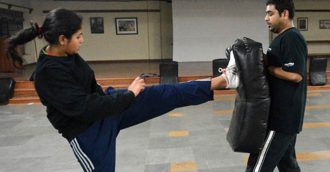 This picture taken on Jan 2, 2013 shows an Indian woman (L) sparring with a trainer during a self defence class in New Delhi. After nearly three weeks of lurid reporting on a horrifying gang-rape in New Delhi, women in the Indian capital say they are more anxious than ever, leading to a surge in interest in self defence classes.  - AFP Photo