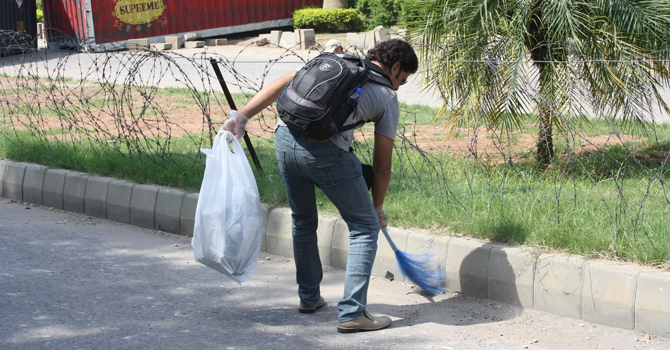 Taking part in #ProjectCleanUpForPeace in September 2012 when he and other Pakistani youths rushed to the streets to clean up the mess created by the angry mob who had protested against an anti-Islam movie.