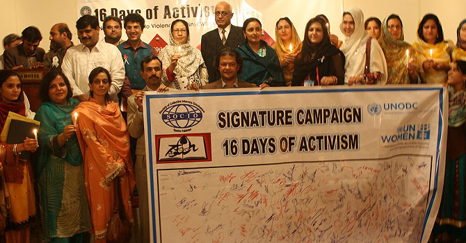 Holding the banner for a 16-day campaign to stop violence against women.