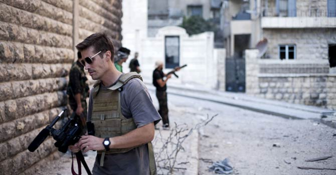 This photo posted on the website freejamesfoley.org shows journalist James Foley in Aleppo, Syria, in Sept, 2012. The family of an American journalist says he went missing in Syria more than one month ago while covering the civil war there. A statement released online Wednesday by the family of James Foley said he was kidnapped in northwest Syria by unknown gunmen on Thanksgiving day. - AP Photo