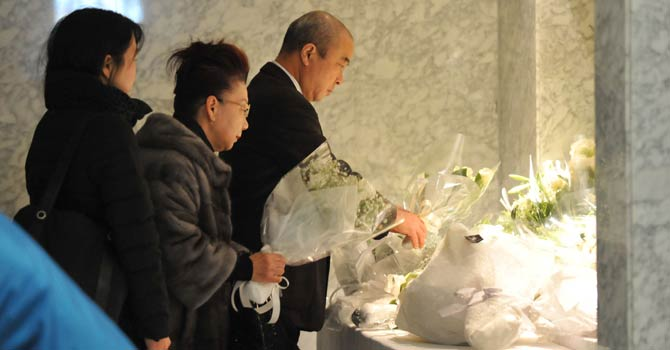 People offer flowers and condolences for Japanese victims who have been confirmed dead, at the Japanese plant construction company JGC headquarters in Yokohama, suburban Tokyo on Jan 24, 2013 following the Algerian hostage crisis in In Amenas when militants struck on Jan 16 at the start of a four-day siege that left dozens of foreigners dead. - AFP Photo