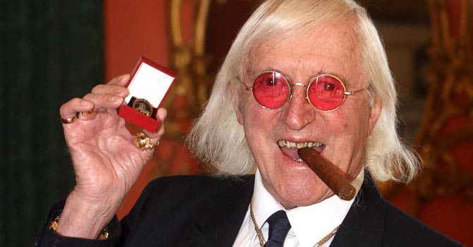 his is a March 25, 2008 file photo of Sir Jimmy Savile, who for decades was a fixture on British television. A year after he died, aged 84 and honored as Sir Jimmy, several women have come forward to claim he was also a sexual predator and serial abuser of underage girls.  -AP Photo