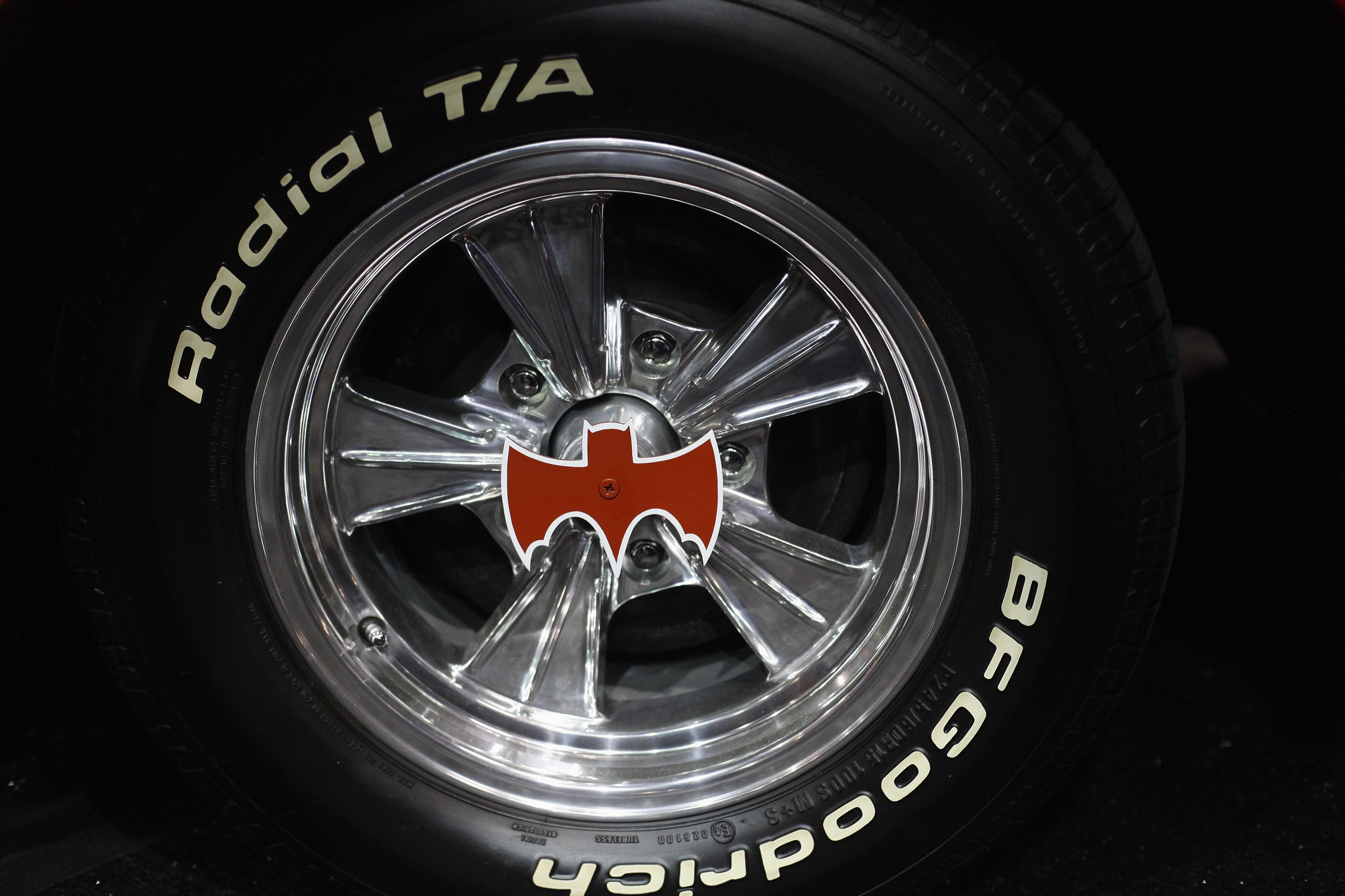 A wheel of the original Batmobile is displayed during the Barrett-Jackson collectors car auction in Scottsdale, Arizona January 19, 2013. The vehicle was sold for $4,200,000, announced the auction company. REUTERS/Joshua Lott (UNITED STATES - Tags: ENTERTAINMENT SOCIETY BUSINESS)