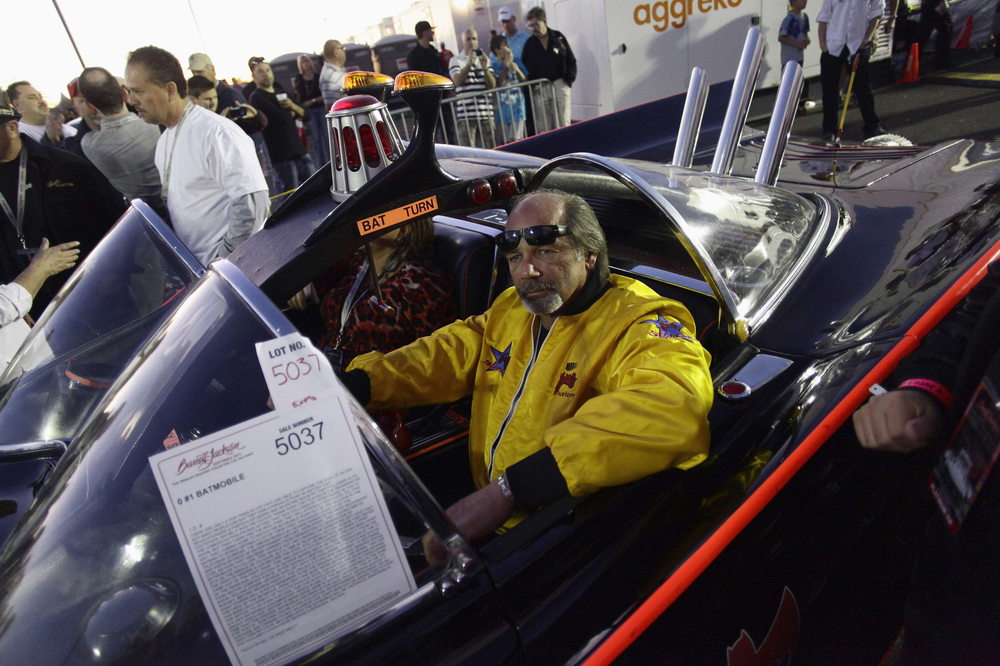 Tony Wood drives the original Batmobile at the Barrett-Jackson collectors car auction in Scottsdale, Arizona January 19, 2013. The vehicle was sold for $4,200,000, according to the auction company. REUTERS/Joshua Lott (UNITED STATES - Tags: ENTERTAINMENT SOCIETY BUSINESS TRANSPORT)