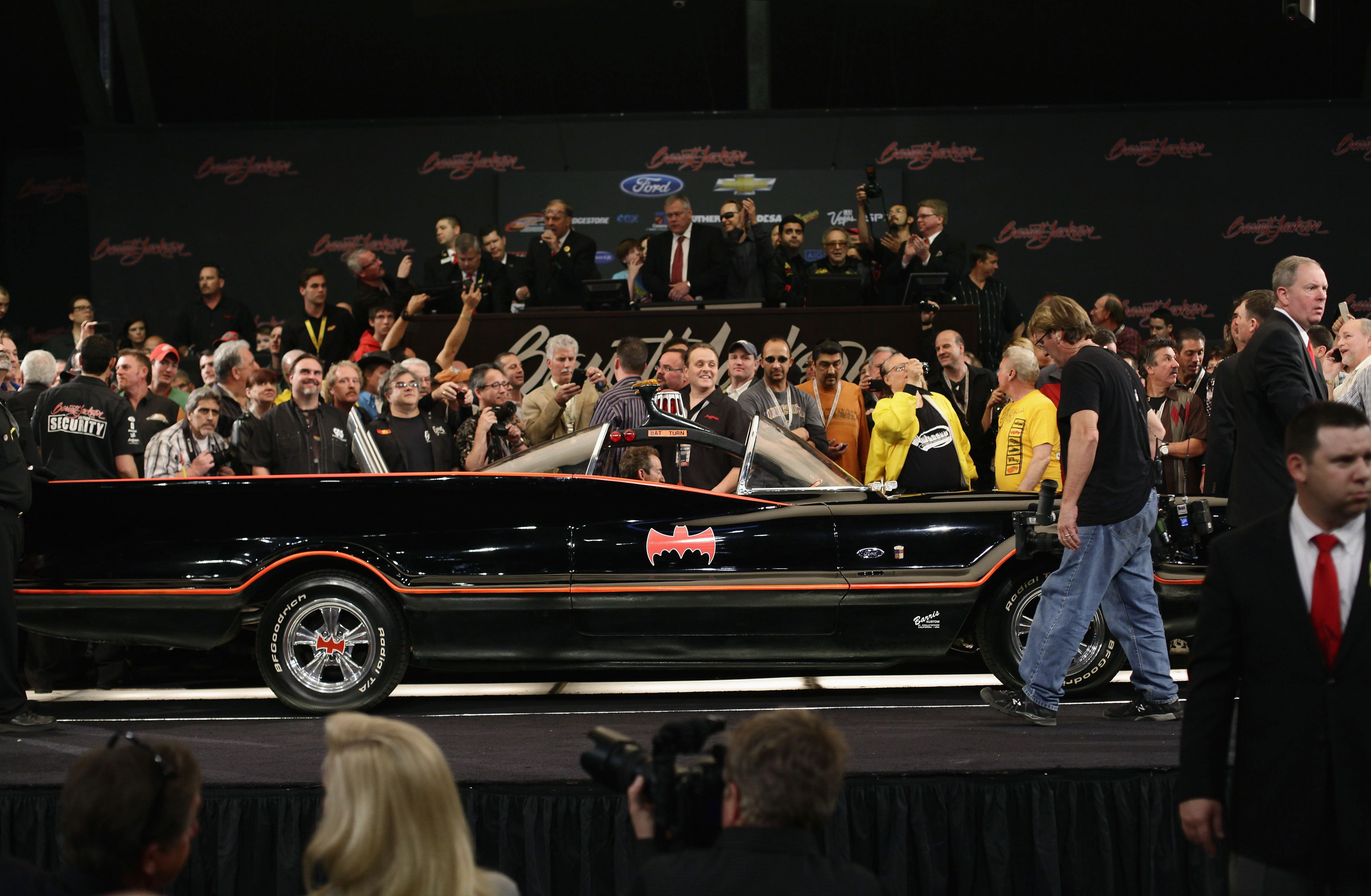 The original Batmobile is displayed on stage during the Barrett-Jackson collectors car auction in Scottsdale, Arizona January 19, 2013. The vehicle was sold for $4,200,000, according to the auction company. REUTERS/Joshua Lott (UNITED STATES - Tags: ENTERTAINMENT SOCIETY BUSINESS TRANSPORT)
