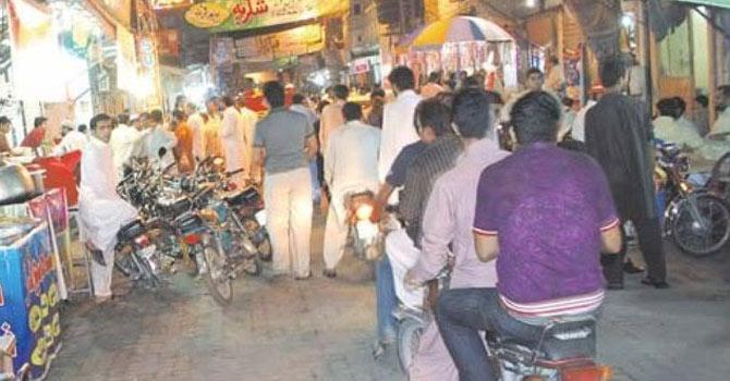 The Kartarpura area of Rawalpindi lights up at night. – File photo by APP