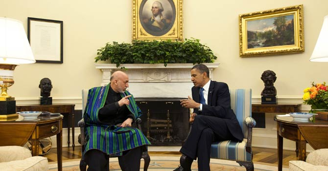 In this file photograph, US President Barack Obama speaks with Afghanistan President Hamid Karzai during a meeting in the Oval Office at the White House in Washington, DC. A key decision on how many US troops will stay on in Afghanistan after 2014 could be made next week at talks between President Barack Obama and Afghan leader Hamid Karzai in Washington, officials say. - AFP Photo