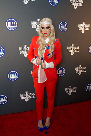 Ke$ha arrives at the 2013 Presidential Inaugural Charity Benefit, on Monday, Jan. 21, 2013 in Washington. — AP Photo