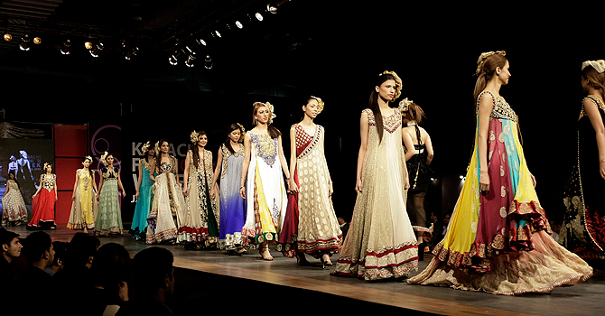 Pakistani models present creations by designer Zeeshan Bariwala on the opening day of Karachi Fashion Week, in Karachi, Pakistan, Sunday, Jan. 27, 2013. (AP Photo/Fareed Khan)