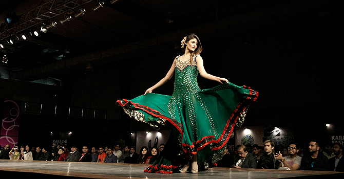 A Pakistani model presents a creation by designer Zeeshan Bariwala on the opening day of Karachi Fashion Week, in Karachi, Pakistan, Sunday, Jan. 27, 2013. (AP Photo/Fareed Khan)