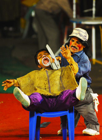 An act between two Indian clowns.