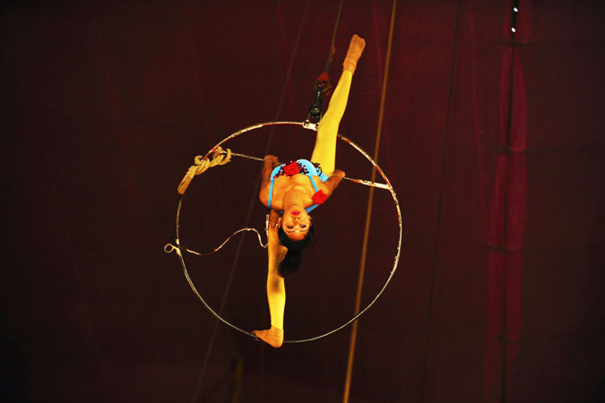Indian female performer goes airborne with only a ring.