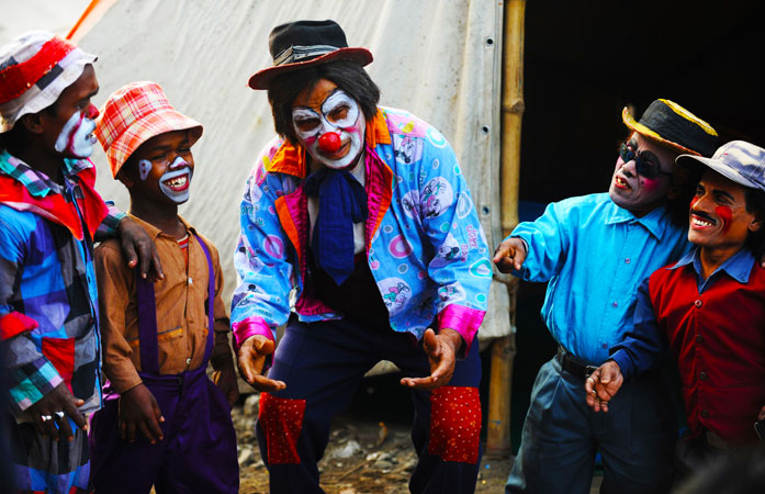 A light moment shared by the Indian clowns before their performance.