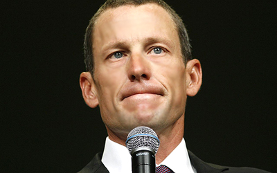 Lance Armstrong speaks during the opening session of the Livestrong Global Cancer Summit in Dublin, Ireland. — AP Photo