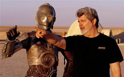 Director George Lucas directs actor Anthony Daniels, who plays the robot C-3PO, in 'Star Wars II: Attack of the Clones', on location in the Tunisian desert. —Photo by AP
