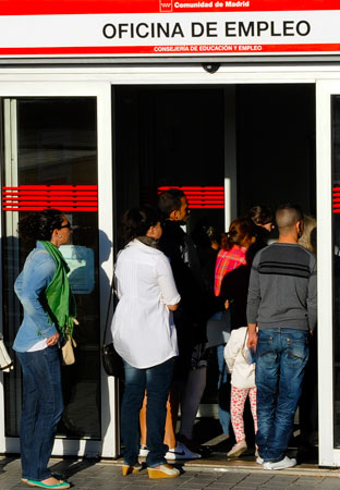 A file photo taken on September 4, 2012, shows people waiting in line at a government employment office in central Madrid, Spain. -Photo by AFP
