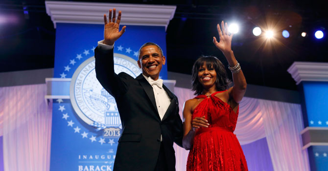 U.S. President Barack Obama and first lady Michelle Obama wave to attendees at the Inaugural Ball in Washington. —Photo by Reuters
