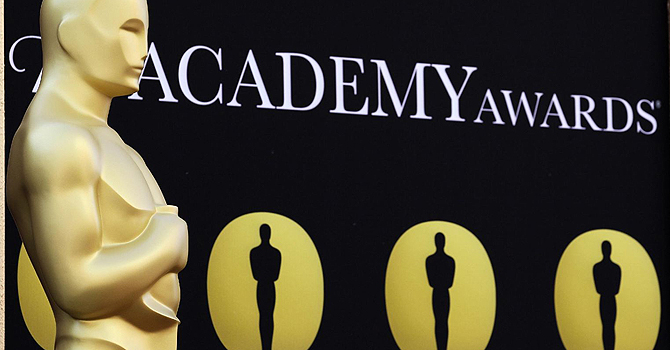 an Oscar statue stands on the red carpet outside the Kodak Theatre as preparations continue for the 82nd Academy Awards in Los Angeles, California. — AP Photo
