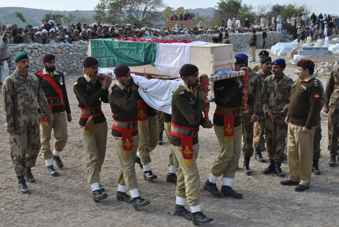 In this photograph taken on January 8, 2013, Pakistani army personnel carry the coffin of soldier Mohammad Aslam, who was killed in a border post attack in the Haji Pir sector in Pakistani Kashmir by the Indian army, during his funeral in Khairpur village Chakwal district. Pakistani and Indian troops exchanged fire on January 6 along their disputed border in Kashmir, with each side accusing the other of starting the clash. Pakistan on January 9 denied an Indian claim that its troops killed two Indian soldiers in a