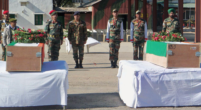 Indian military personnel pay their respects in front of the caskets bearing the bodies of Indian soldiers Lance Naik (Corporal) Sudhakar Singh and Lance Naik Hemraj, killed during a skirmish in the disputed Kashmir region, before their departure from Rajouri, some 150kms from Jammu, on January 9, 2013, allegedly killed by Pakistani soldiers during a skirmish in the disputed Kashmir region, before their departure from Rajouri, some 150kms from Jammu, on January 9, 2013.