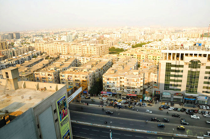 Gulistan-i-Jauhar, a relatively new area in Karachi, comprises a concrete jungle of high rise apartments and housing schemes. – Photo by Faysal Mujeeb / White Star