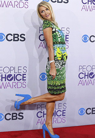Socialite Paris Hilton poses as she arrives at the 2013 People's Choice Awards in Los Angeles.?Photo by Reuters