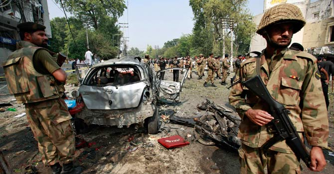 Army soldiers guard the site of a bomb blast in Peshawar - File photo by Reuters